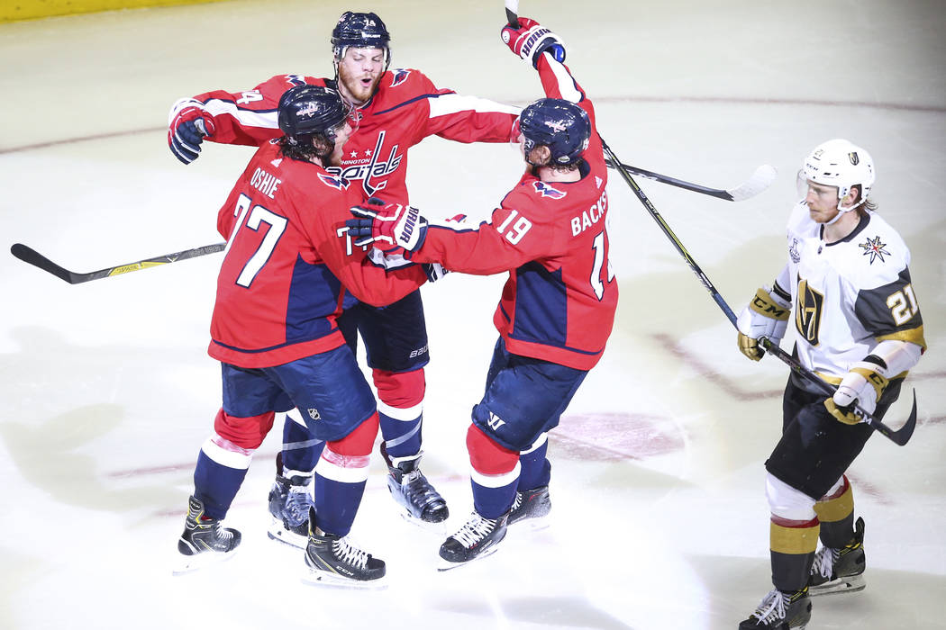 Washington Capitals players celebrate a goal by defenseman John Carlson, second from left, during the second period of Game 4 of the Stanley Cup Final against the Golden Knights at Capital One Are ...