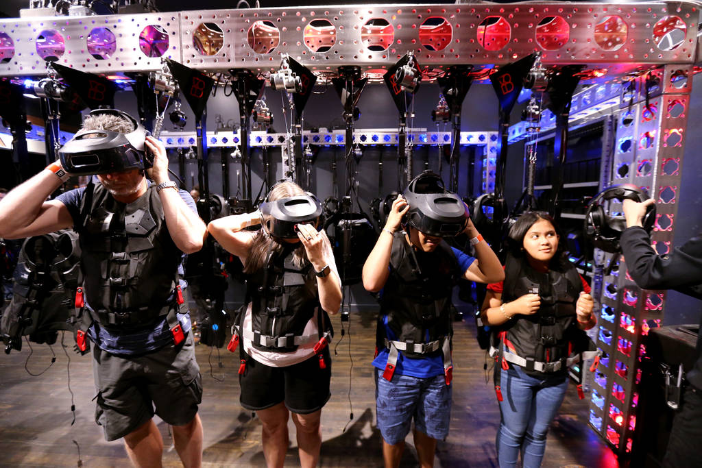 Thomas Bladh and Eva Zander of Sweden, left, and Thirdy and Chloe Aldevera of the Philippines don their headsets at The VOID immersive virtual reality attraction at Grand Canal Shoppes in The Vene ...