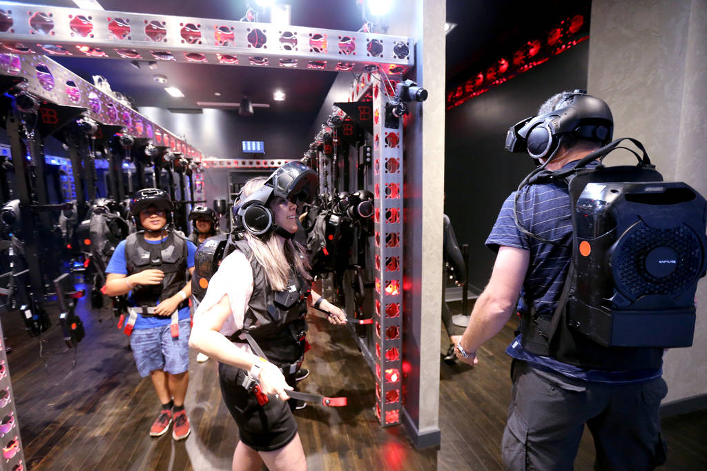 Thomas Bladh and Eva Zander of Sweden, right, followed by Thirdy and Chloe Aldevera of the Philippines walk to their adventure at The VOID immersive virtual reality attraction at Grand Canal Shopp ...