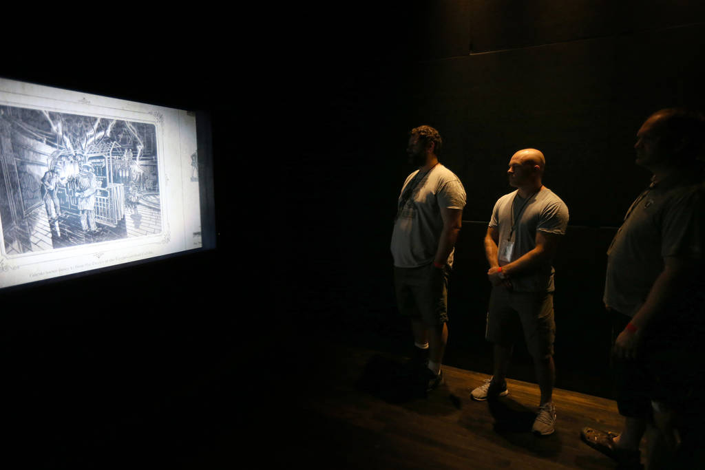 "Guests watch a video in the briefing room for ""Nicodemus: Demon of Evanishment"" at The VOID immersive virtual reality attraction at Grand Canal Shoppes in The Venetian Tuesday, June 12, ..."
