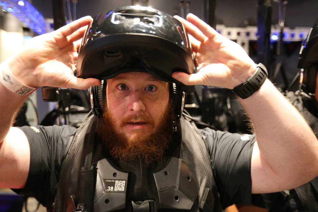 "Sean Brown of Las Vegas prepares his headset at The VOID immersive virtual reality attraction at Grand Canal Shoppes in The Venetian Tuesday, June 12, 2018. A new adventure, ""Nicodemus: Demon ..."