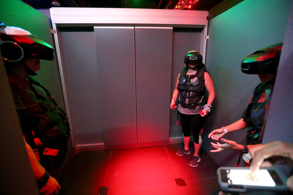 Ross Bryant, from left, Teresa Ulring and Alex Sawin of Las Vegas prepare for an adventure at The VOID immersive virtual reality attraction at Grand Canal Shoppes in The Venetian Tuesday, June 12, ...