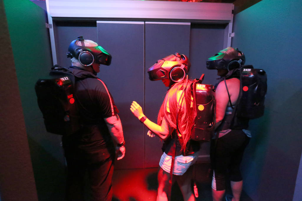 Ross Bryant, from left, Alex Sawin and Teresa Ulring of Las Vegas prepare for an adventure at The VOID immersive virtual reality attraction at Grand Canal Shoppes in The Venetian Tuesday, June 12 ...