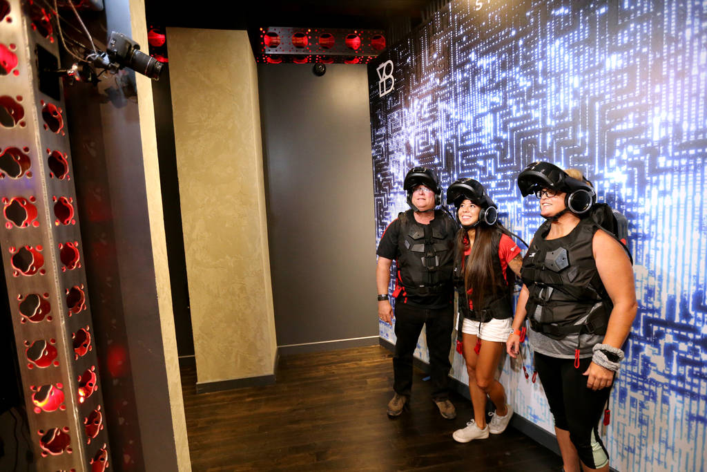 Ross Bryant, from left, Alex Sawin and Teresa Ulring of Las Vegas pose for a photo after an adventure at The VOID immersive virtual reality attraction at Grand Canal Shoppes in The Venetian Tuesd ...