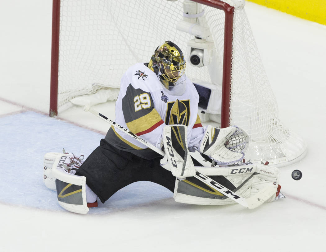 Golden Knights goaltender Marc-Andre Fleury (29) makes a save in the first period during Game 4 of the NHL Stanley Cup Final against the Washington Capitals on Monday, June 4, 2018, at Capital One ...