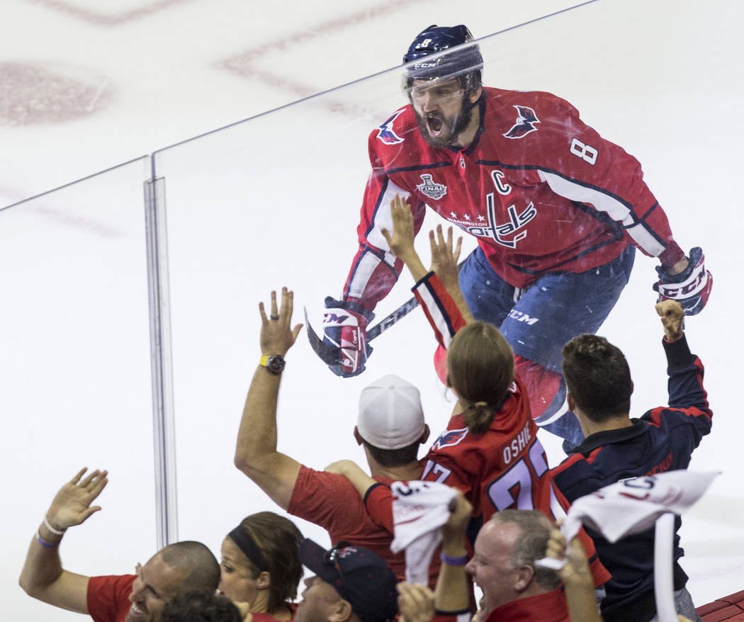 Capitals left wing Alex Ovechkin (8) celebrates after teammate Devante Smith-Pelly scored a first-period goal during Game 4 of the NHL Stanley Cup Final against the Golden Knights on Monday, June ...