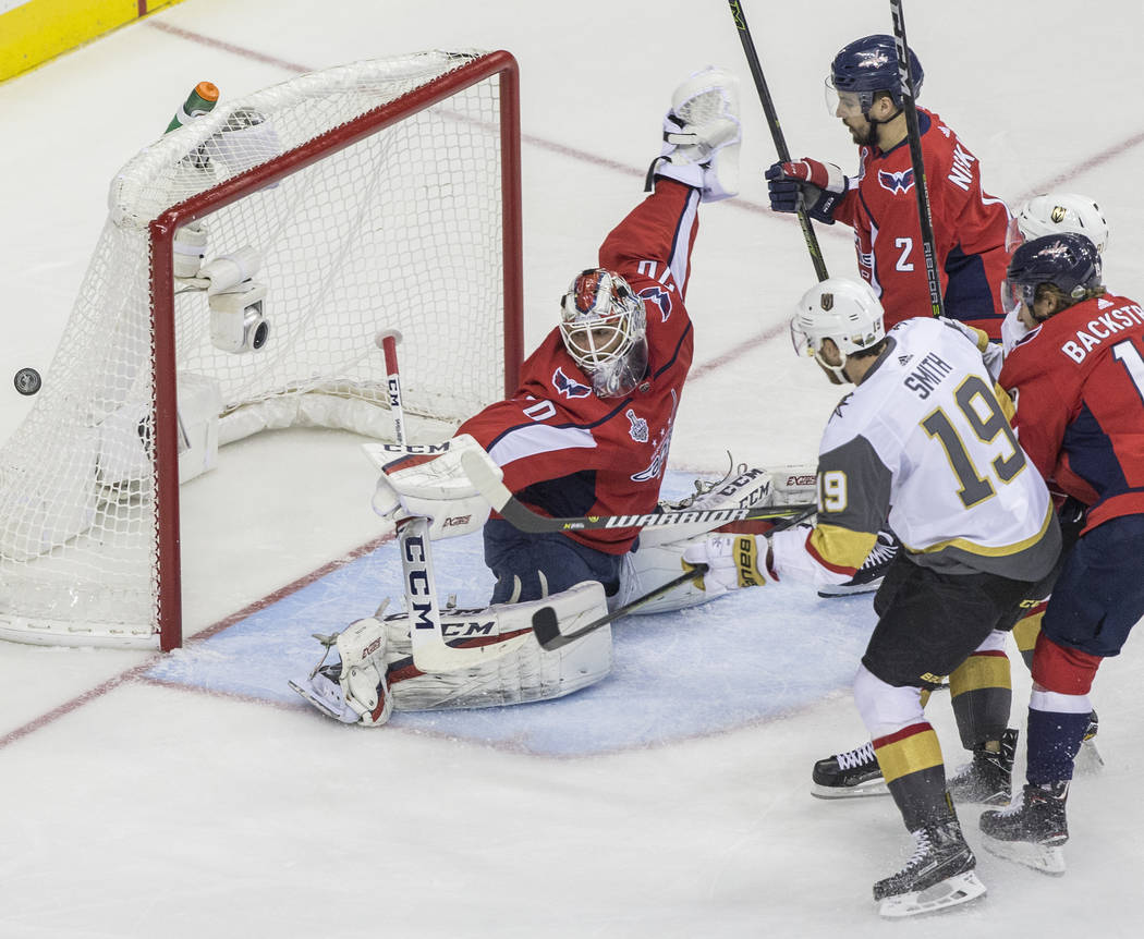 Golden Knights right wing Reilly Smith (19) shoots on Capitals goaltender Braden Holtby (70) in the first period during Game 4 of the NHL Stanley Cup Final on Monday, June 4, 2018, at Capital One ...