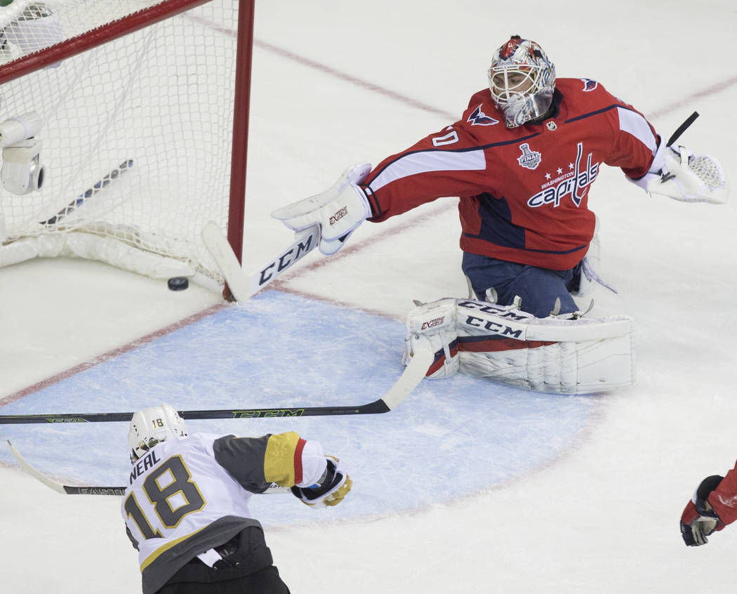 Capitals goaltender Braden Holtby (70) makes a first-period save against Golden Knights left wing James Neal (18) during Game 4 of the NHL Stanley Cup Final on Monday, June 4, 2018, at Capital One ...