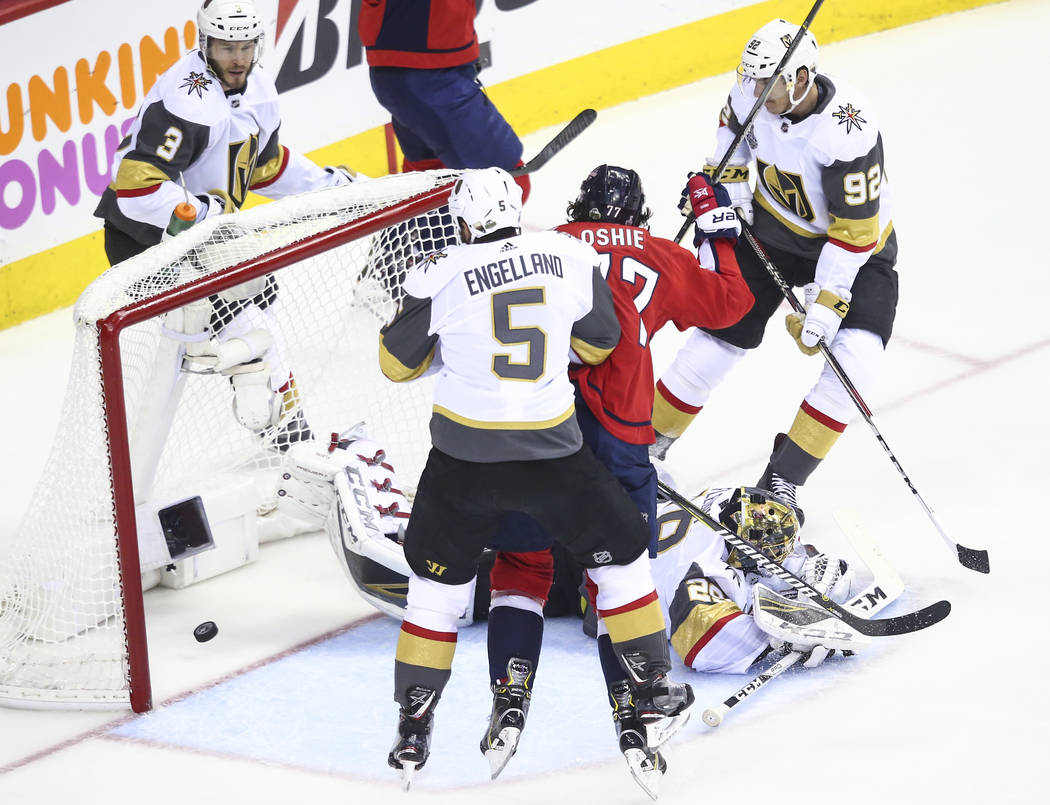 Washington Capitals right wing T.J. Oshie (77) scores against Golden Knights goaltender Marc-Andre Fleury (29) during the first period of Game 4 of the Stanley Cup Final at Capital One Arena in Wa ...