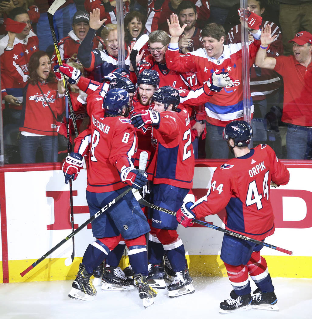 Washington Capitals players celebrate a goal by right wing Tom Wilson (43) during the first period of Game 4 of the Stanley Cup Final against the Golden Knights at Capital One Arena in Washington ...