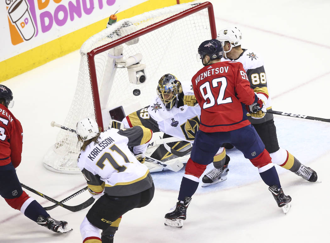 Washington Capitals right wing Devante Smith-Pelly (25) scores past Golden Knights goaltender Marc-Andre Fleury (29) during the first period of Game 4 of the Stanley Cup Final at Capital One Arena ...
