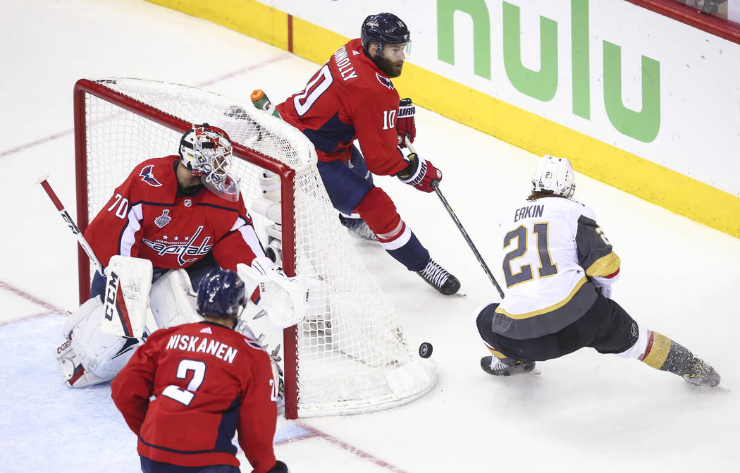 Golden Knights center Cody Eakin (21) and Washington Capitals right wing Brett Connolly (10) battle for the puck during the first period of Game 4 of the Stanley Cup Final at Capital One Arena in ...