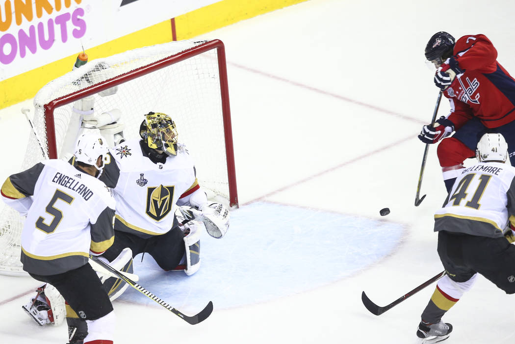 Washington Capitals right wing T.J. Oshie (77) sends the puck in to score past Golden Knights goaltender Marc-Andre Fleury (29) during the first period of Game 4 of the Stanley Cup Final at Capita ...