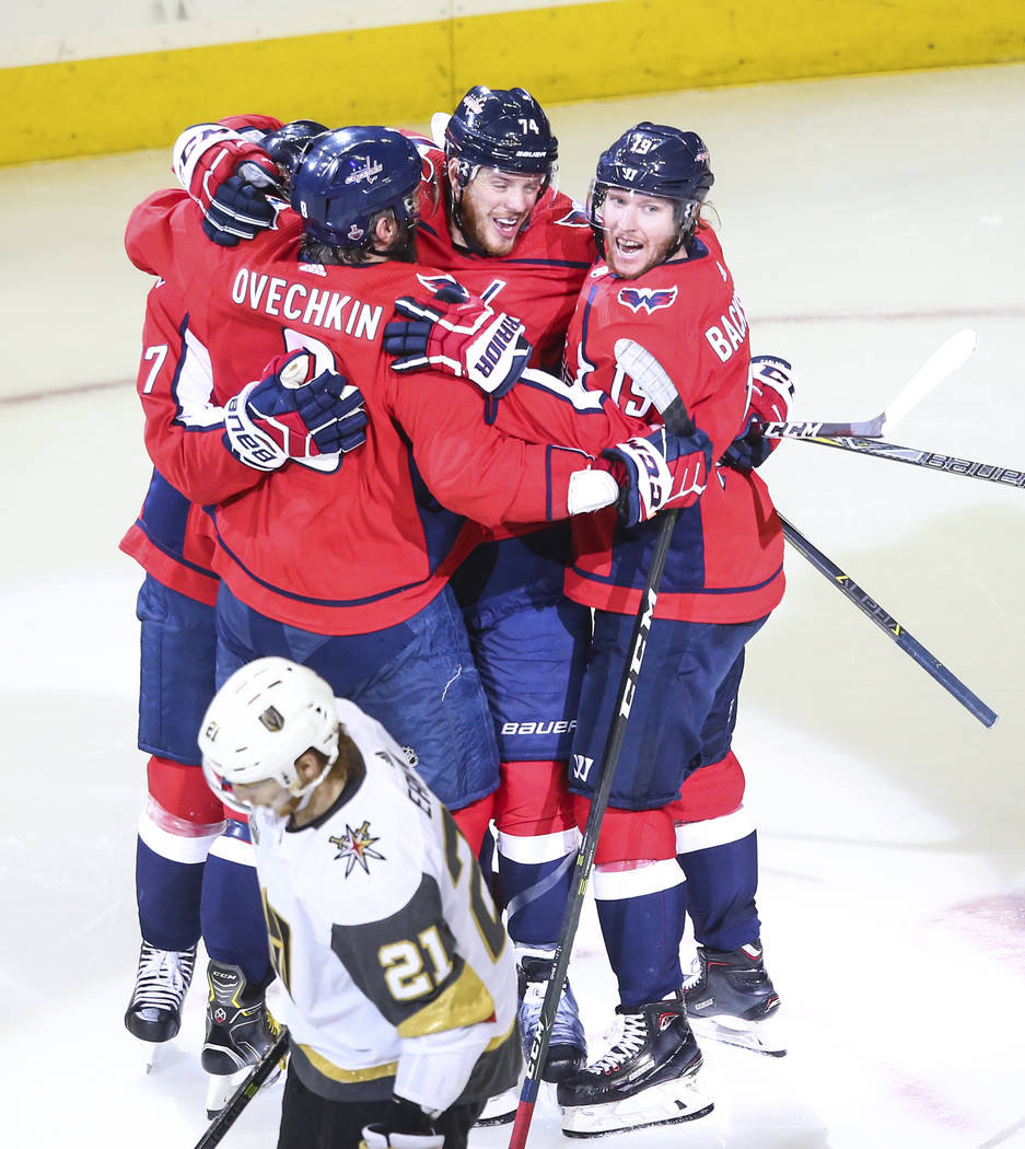 Washington Capitals players celebrate a goal by defenseman John Carlson during the second period of Game 4 of the Stanley Cup Final against the Golden Knights at Capital One Arena in Washington on ...