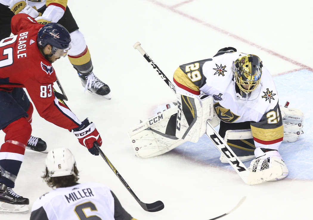 Golden Knights goaltender Marc-Andre Fleury (29) blocks a shot in front of Washington Capitals center Jay Beagle (83) during the second period of Game 4 of the Stanley Cup Final at Capital One Are ...