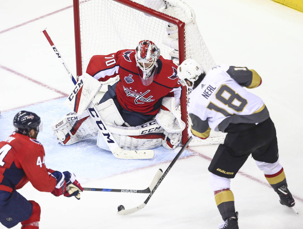 Golden Knights left wing James Neal (18) lines up a shot to score past Washington Capitals goaltender Braden Holtby (70) during the third period of Game 4 of the Stanley Cup Final at Capital One A ...