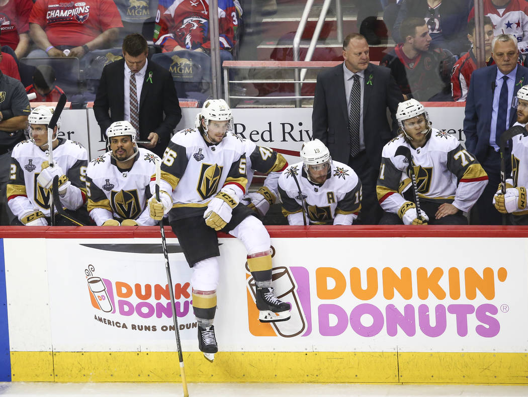 Golden Knights players react as they trail the Washington Capitals during the third period of Game 4 of the Stanley Cup Final at Capital One Arena in Washington on Monday, June 4, 2018. Chase Stev ...