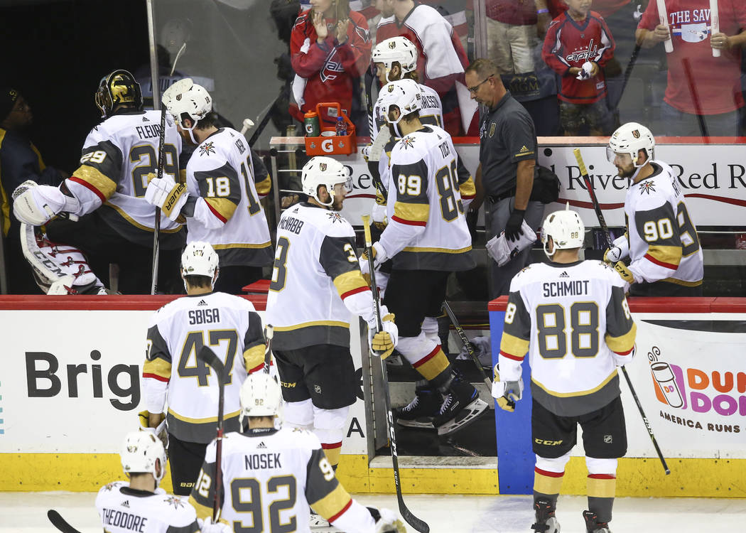 Golden Knights players head to the locker room after losing 6-2 to the Washington Capitals during the third period of Game 4 of the Stanley Cup Final at Capital One Arena in Washington on Monday, ...