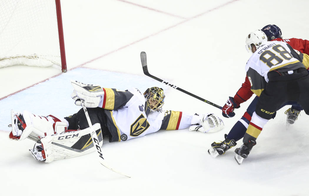 Golden Knights goaltender Marc-Andre Fleury (29) dives to block a shot from the Washington Capitals during the third period of Game 4 of the Stanley Cup Final at Capital One Arena in Washington on ...