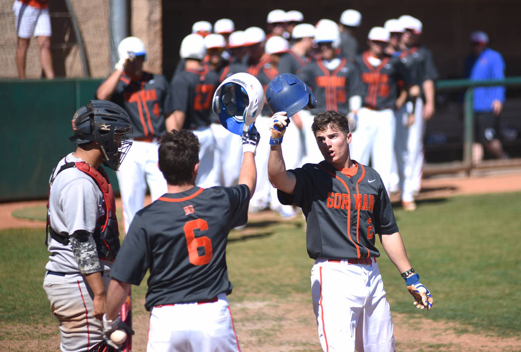 Bishop Gorman's Cadyn Grenier (2) is congratulated by teammate Noah Serrano (6) after hitting a home run during their baseball game played against Liberty High at the Bishop Gorman baseball field ...