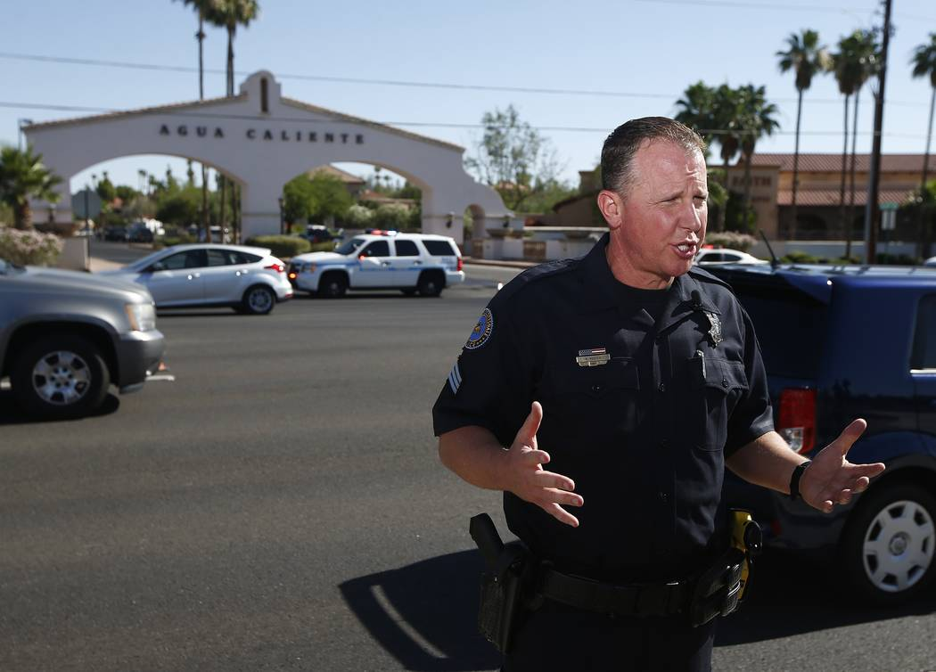 Scottsdale Police Department Sgt. Ben Hoster speaks to the media after local police surrounded a local hotel where a suspect wanted in four killings was staying Monday, June 4, 2018, in Scottsdale ...