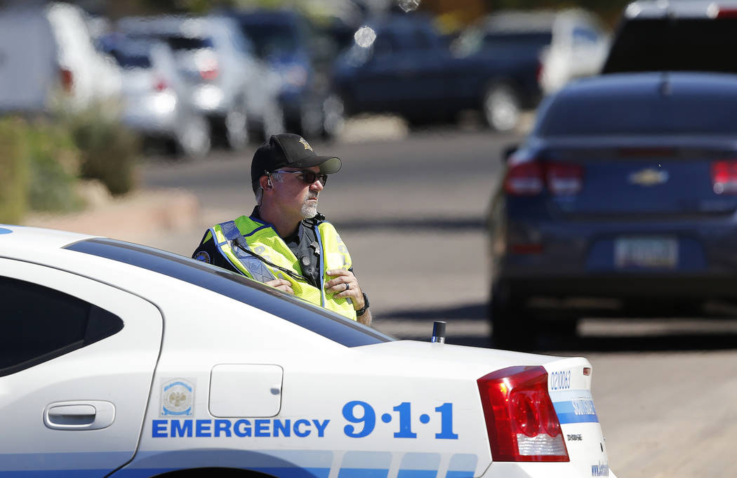 A Scottsdale Police Department officer blocks off traffic as police surround a local hotel where a suspect wanted in several killings was staying Monday, June 4, 2018, in Scottsdale, Ariz. Accordi ...