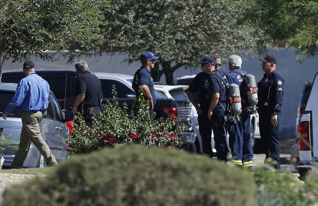 Emergency personnel surround a hotel where a suspect wanted in multiple killings was staying Monday, June 4, 2018, in Scottsdale, Ariz. According to police, the suspect killed himself as police cl ...