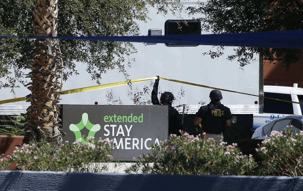 Police work at a hotel where a suspect wanted in several killings was staying Monday, June 4, 2018, in Scottsdale, Ariz. According to police, the suspect killed himself as police closed in on the ...