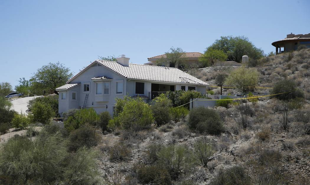 Police tape blocks off a home, as they investigate additional killings in the home, related to other Scottsdale, Ariz., victims killed over the past several days Monday, June 4, 2018, in Fountain ...