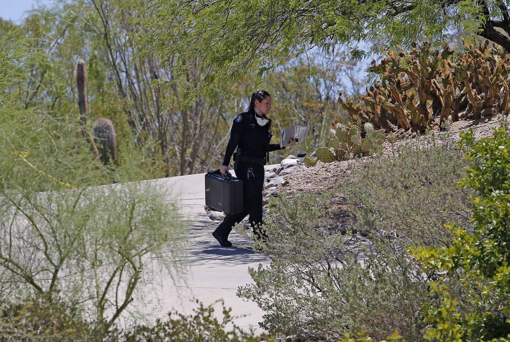 A police investigator arrives at a home where police say additional killings took place, and are related to other Scottsdale, Ariz., victims killed over the past several days Monday, June 4, 2018, ...
