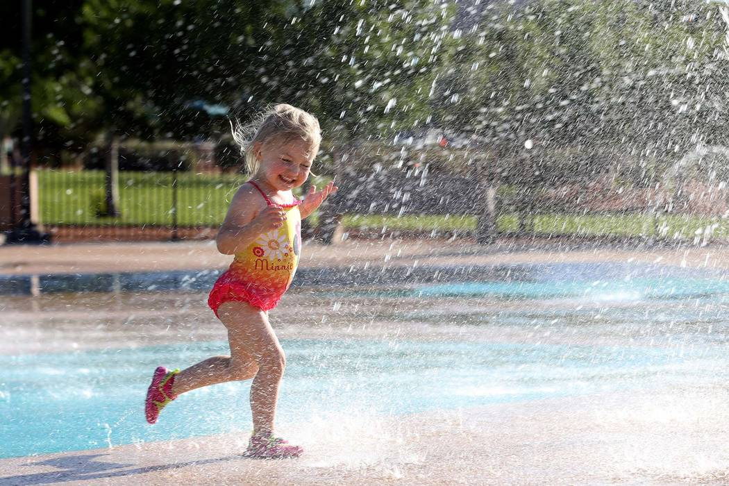 Summer Rae Smith, 3, of Henderson plays on the splash pad at Paseo Vista Park in Henderson. (K.M. Cannon/ Las Vegas Review-Journal) @KMCannonPhoto