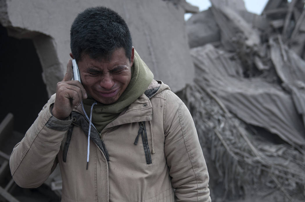 """Boris Rodriguez, 24, who is searching for his wife, cries after seeing the condition of his neighborhood, destroyed by the erupting Volcan de Fuego, or """"Volcano of Fire,"""" in Escuintla, G ..."""