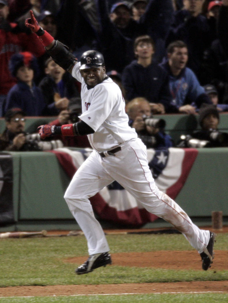 FILE- In this Oct. 18, 2004, file photo, Boston Red Sox's David Ortiz celebrates his 14th inning game-winning single that scored teammate Johnny Damon to beat the New York Yankees 5-4 in Game 5 of ...