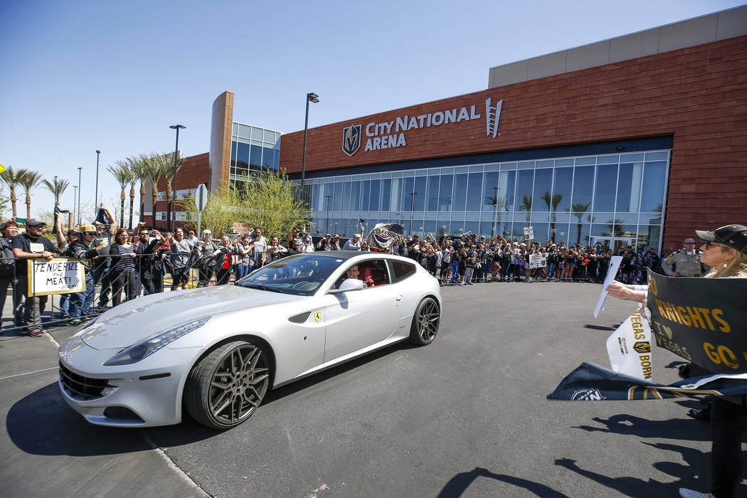 Vegas Golden Knights goaltender Marc-Andre Fleury leaves the City National Arena as fans cheer during a send-off event ahead of Games 3 and 4 of the NHL playoff series against Los Angeles Kings on ...