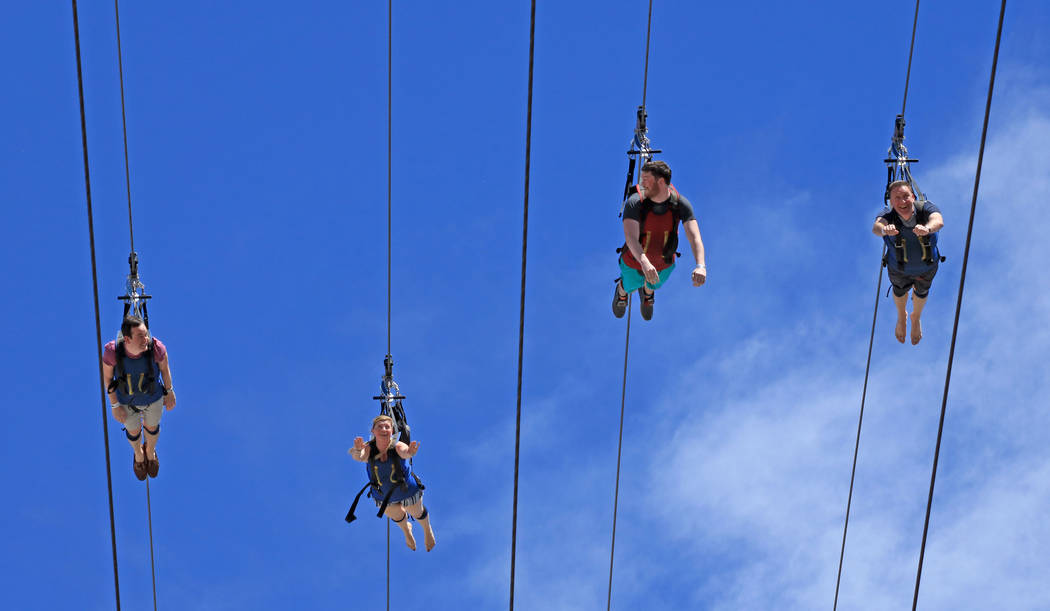 Tourists zoom out of the SlotZilla Zip Line near the Fremont Street Experience, Thursday, May 25, 2017. Gabriella Benavidez Las Vegas Review-Journal @latina_ish
