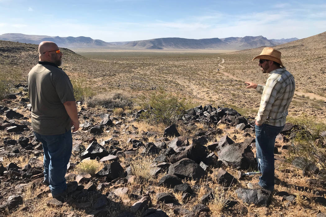 Patrick Donnelly from the Center for Biological Diversity, right, and Jim Stanger, president of the Friends of Sloan Canyon, look out Tuesday over Hidden Valley, south of Henderson, wher ...