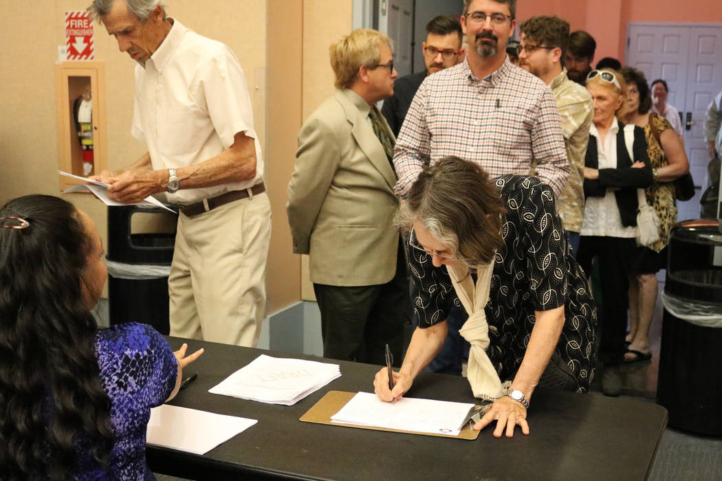 Hermi Hiatt of Las Vegas signs in to a public meeting at the Clark County Library in Las Vegas, Tuesday, June 5, 2018. A crowd filled the Clark County Library conference room Tuesday afternoon whe ...