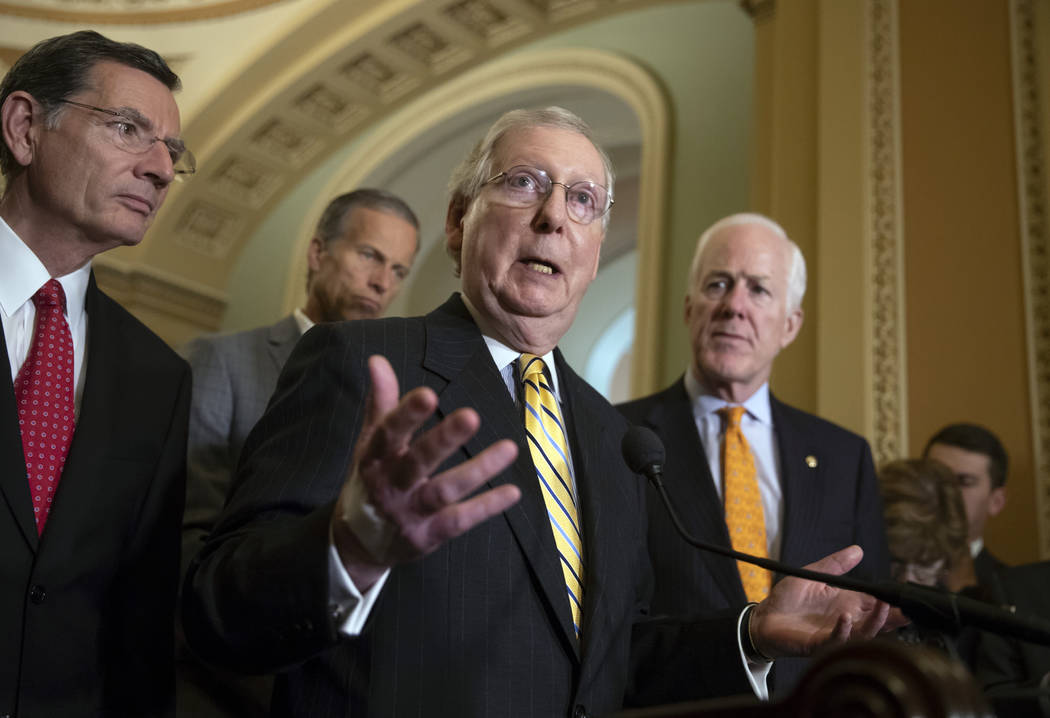 Senate Majority Leader Mitch McConnell, R-Ky., center, joined from left by, Sen. John Barrasso, R-Wyo., Sen. John Thune, R-S.D., and Majority Whip John Cornyn, R-Texas, tells reporters he intends ...