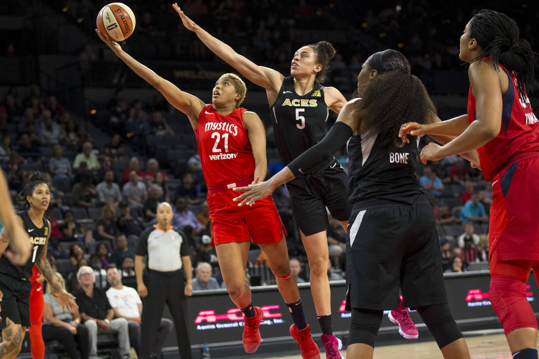 Washington Mystics forward Tianna Hawkins (21) takes a shot against Las Vegas Aces forward Dearica Hamby (5) in the first half of a WNBA basketball game at the Mandalay Bay Events Center in Las Ve ...