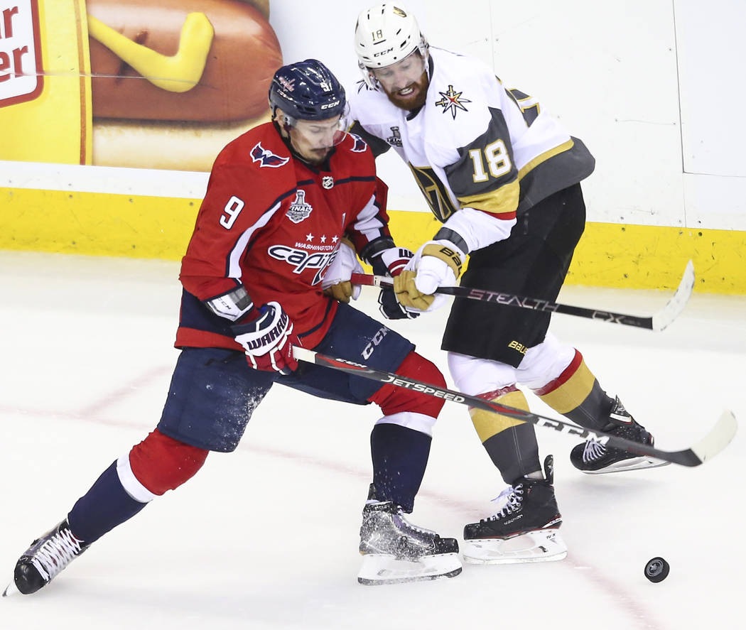 Washington Capitals defenseman Dmitry Orlov (9) and Golden Knights left wing James Neal (18) battle for the puck during the second period of Game 4 of the Stanley Cup Final at Capital One Arena in ...