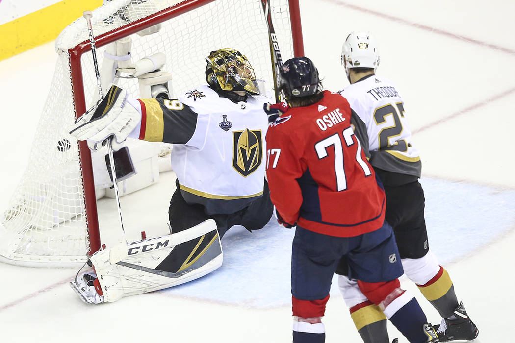 be1456168 Golden Knights goaltender Marc-Andre Fleury (29) gets scored on by  Washington Capitals