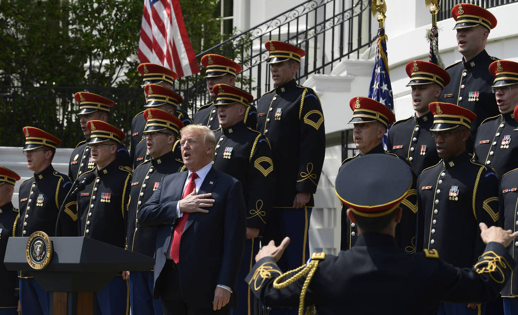 """President Donald Trump sings the National Anthem during a """"Celebration of America"""" event at the White House, Tuesday, June 5, 2018, in Washington, in lieu of a Super Bowl celebration for ..."""