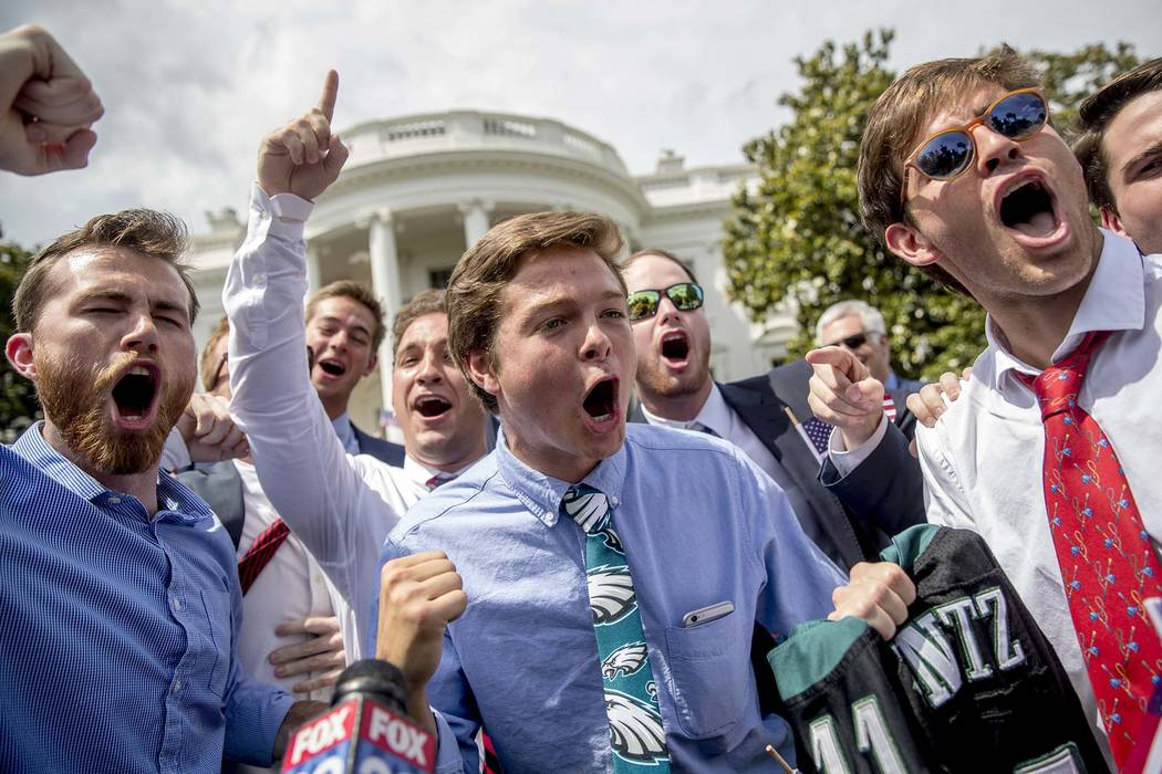 """Philadelphia Eagles fans sing the Eagles fight song during the """"Celebration of America"""" event on the South Lawn of the White House, Tuesday, June 5, 2018, in Washington. President Donald ..."""