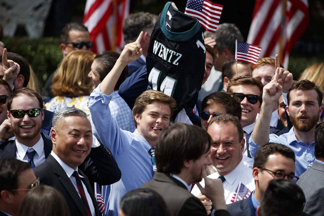 """An Philadelphia Eagles fan carries the jersey of quarterback Carson Wentz during a """"Celebration of America"""" event at the White House, Tuesday, June 5, 2018, in Washington, in lieu of a S ..."""