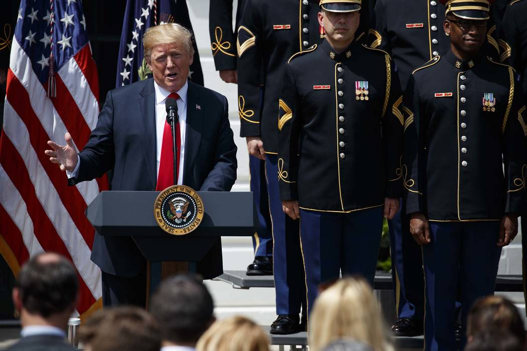 """President Donald Trump speaks during a """"Celebration of America"""" event at the White House, Tuesday, June 5, 2018, in Washington, in lieu of a Super Bowl celebration for the NFL's Philadel ..."""