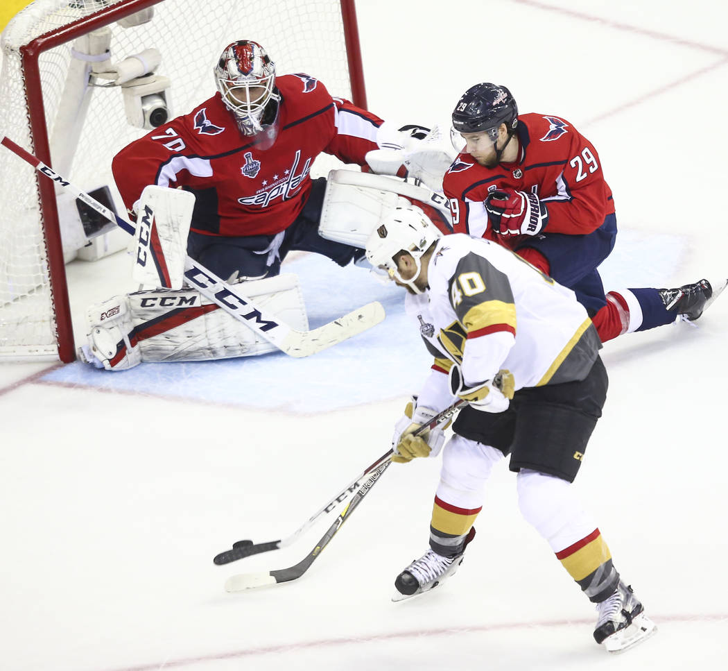 Golden Knights center Ryan Carpenter (40) shoots against Washington Capitals goaltender Braden Holtby (70) during the second period of Game 4 of the Stanley Cup Final at Capital One Arena in Washi ...