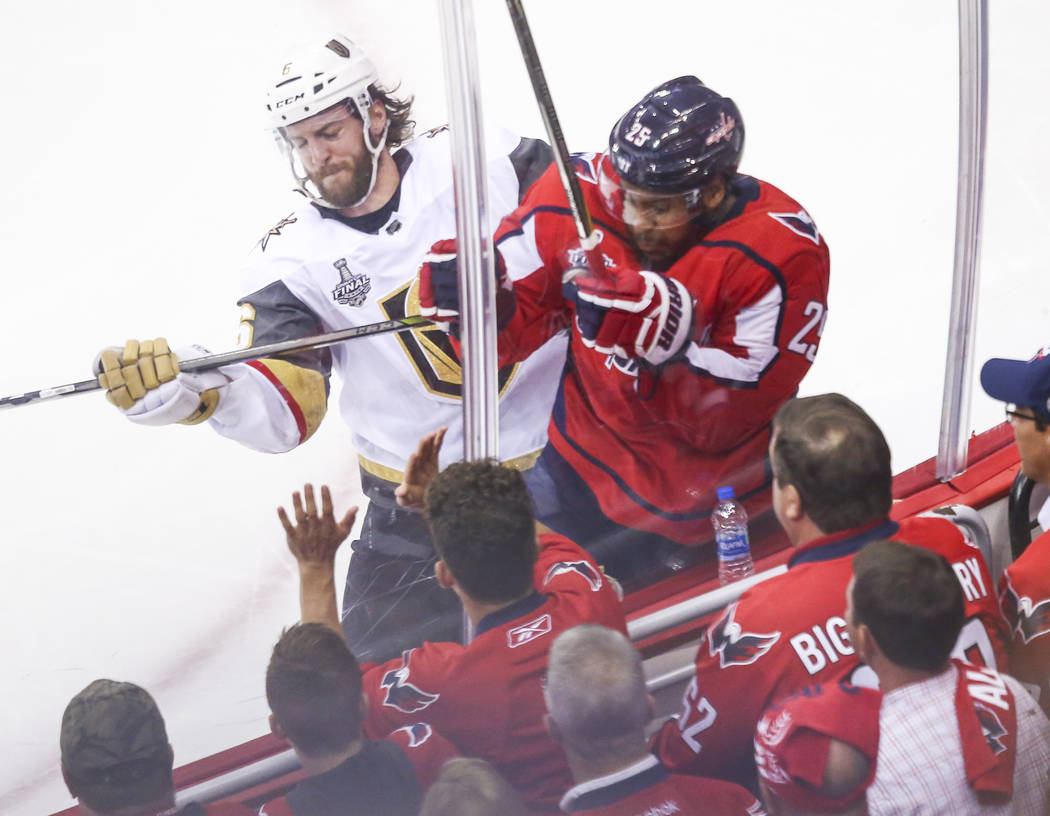 Golden Knights defenseman Colin Miller (6) checks Washington Capitals right wing Devante Smith-Pelly (25) during the second period of Game 4 of the Stanley Cup Final at Capital One Arena in Washin ...