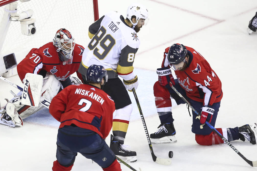 Golden Knights right wing Alex Tuch (89) and Washington Capitals defenseman Brooks Orpik (44) battle for the puck in front of goaltender Braden Holtby (70) during the second period of Game 4 of th ...
