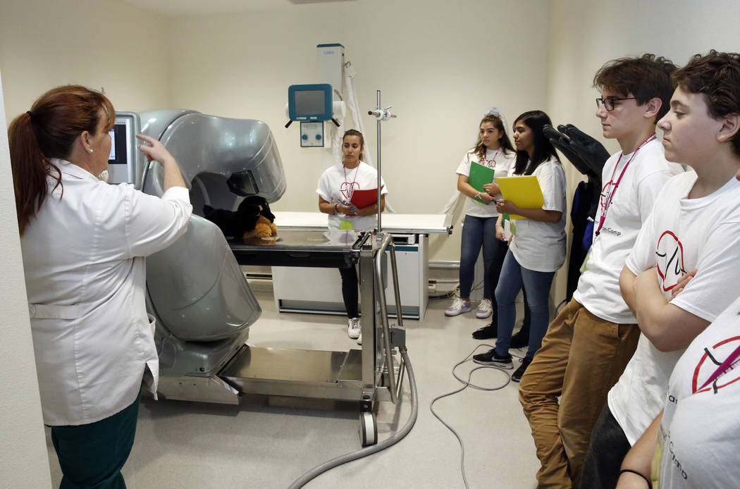 Melissa Schalles, veterinary clinic manager at College of Southern Nevada, demonstrates a CAT scan to Clark County High School students during CSN's inaugural Health Career Exploration Camp at CSN ...