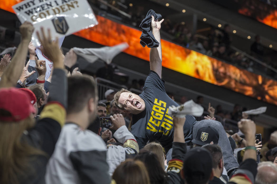 """Cameron Hughes, """"The Igniter,"""" riles up the home crowd third period of game two of their first-round playoff series on Friday, April 13, 2018, at T-Mobile Arena, in Las Vegas. Benjamin Hager Las V ..."""